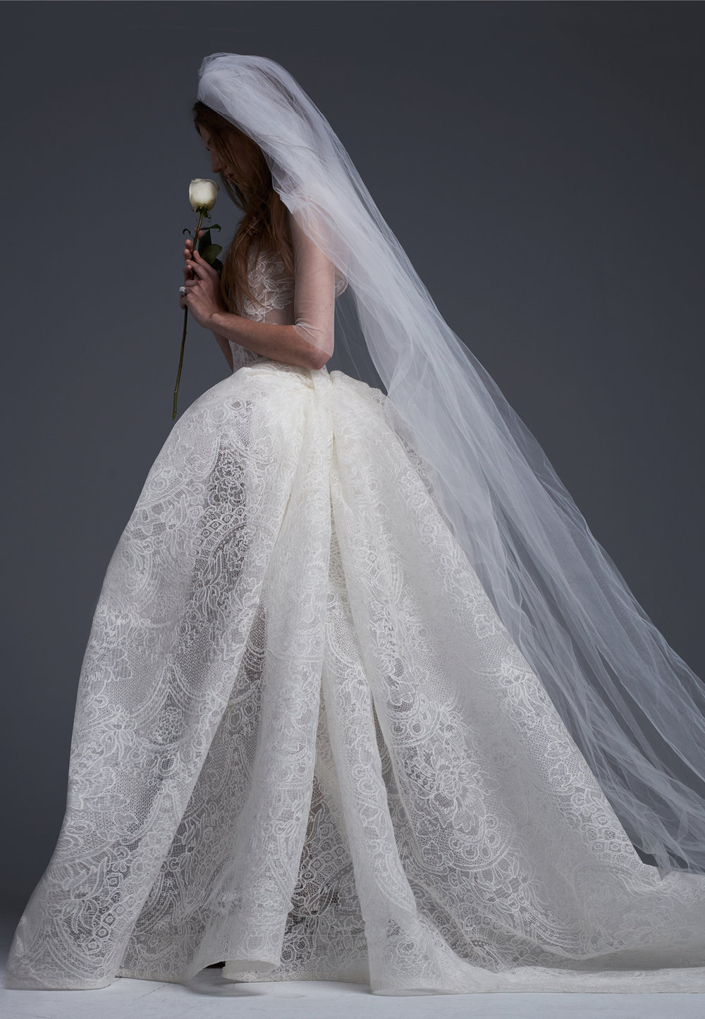 Season: Fall 2017    Gown name: Juliette    Description: A macramé lace ballgown with draped skirt and lace applique and bridal accent buttons.