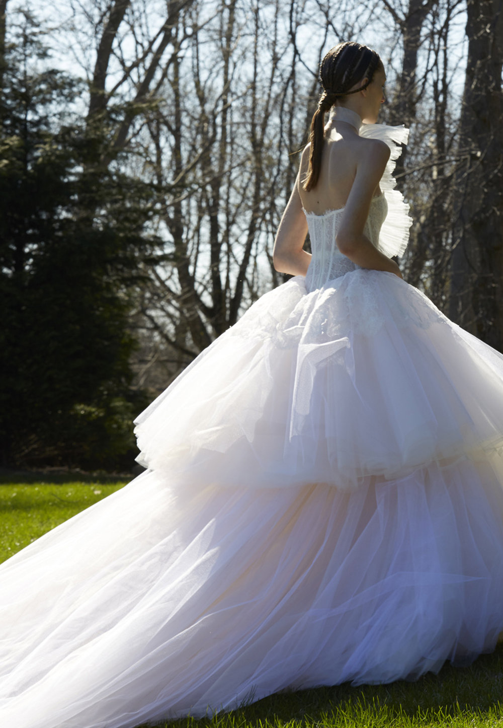 Season: Spring 2017    Gown name: Sigourney    Description: A two-tiered tulle ball gown with a lace overlay on bodice and cathedral length train.