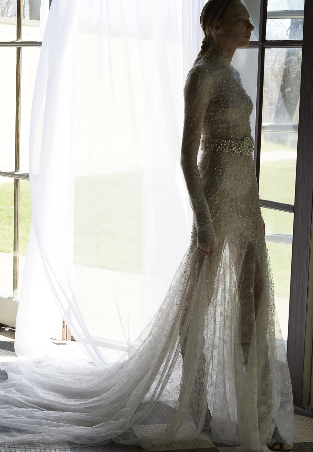 Season: Spring 2017    Gown name: Wavely    Description: A long sleeve, lace gown with applique lace details on French tulle overlay.