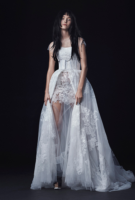 Season: Fall 2016    Gown name: Lucia    Description: A light ivory hand applique Chantilly lace cap sleeve A-line gown with center front split at the skirt over a hand applique Chantilly lace mini skirt.