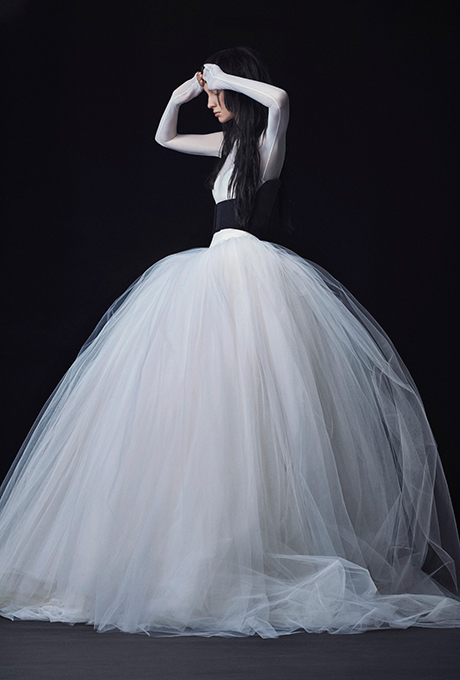 Season: Fall 2016    Gown name: Fernanda    Description: A light ivory long sleeve stretch illusion and silk satin faced organza ball gown with basque waist and dramatic tulle skirt.