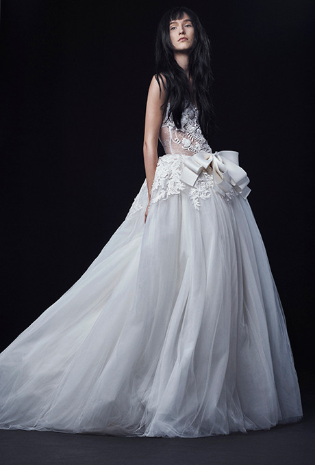 Season: Fall 2016    Gown name: Cristina    Description: A light ivory lingerie neckline Chantilly lace ball gown with hand applique guipure lace and intricate passementiere accented by a silk bow at the waist.