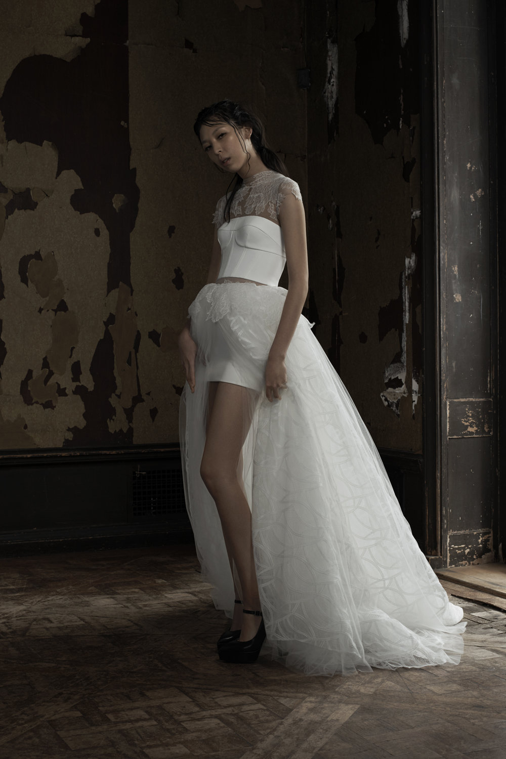 Season: Spring 2016    Gown name: Alejandra    Description: A soft white slit tulle and geometric lace skirt ball gown with classic corset detail bodice accented by hand applique Chantilly lace at the neckline, cap sleeve and skirt.