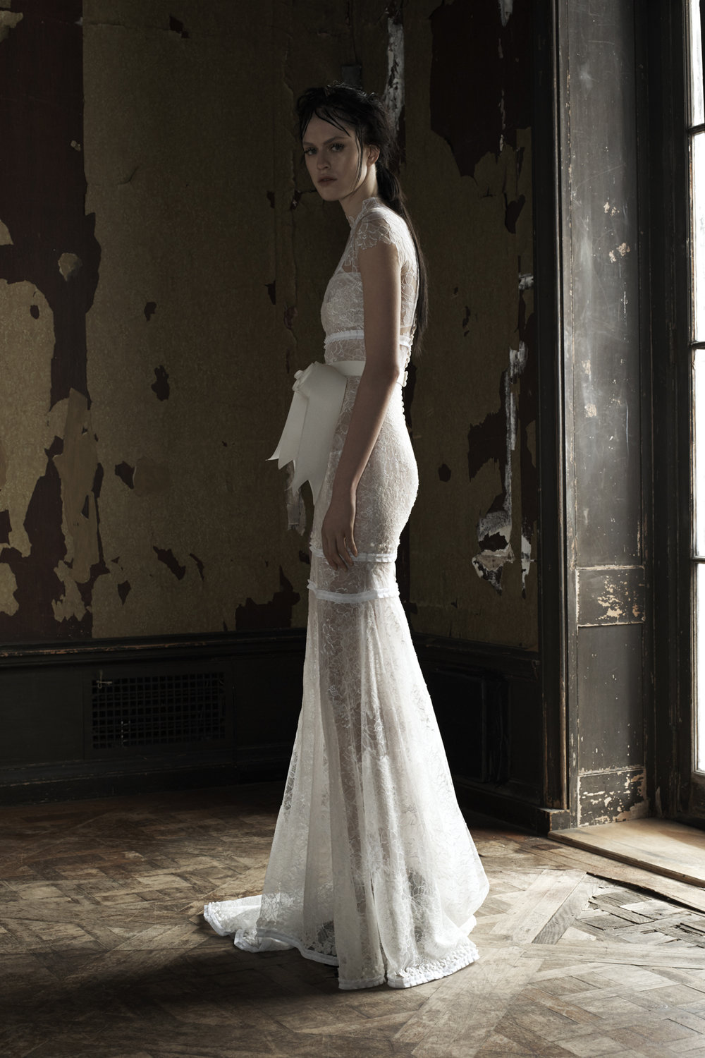 Season: Spring 2016    Gown name: Isabel    Description: A light ivory cap sleeve hand applique Chantilly lace soft mermaid gown with pleated ribbon and silk flower trim accented by double row bridal buttons down the back.