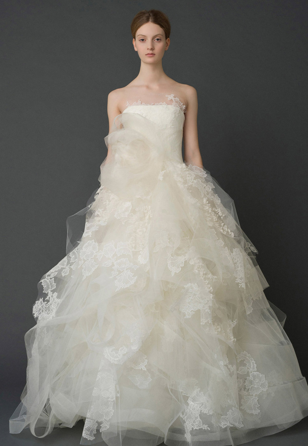 Iconic Style    Gown Name: Helena    Description: A strapless soft ball gown with floating lace and organza sprig appliques with hand-tacked voluminous framed horsehair overskirt.