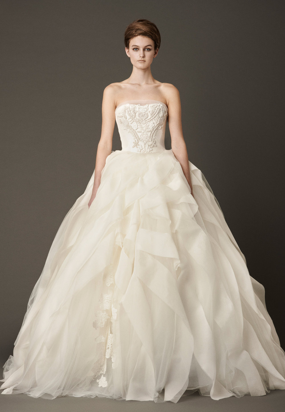 Iconic Style    Gown Name: Liesel 桃心形領口公主大裙婚紗    Description: 桃心形領口公主大裙婚紗,上身綴以手工刺繡細節,下擺不但有蕾絲貼花為 特色細節,更飾有似是一條條絲帶隨意組合的絲綢透明紗。這是一襲集傳統、時尚與夢幻 於一身的婚紗,又如海浪般起伏的裙擺,自然地形成不對稱效果,如夢幻舞會的禮服。