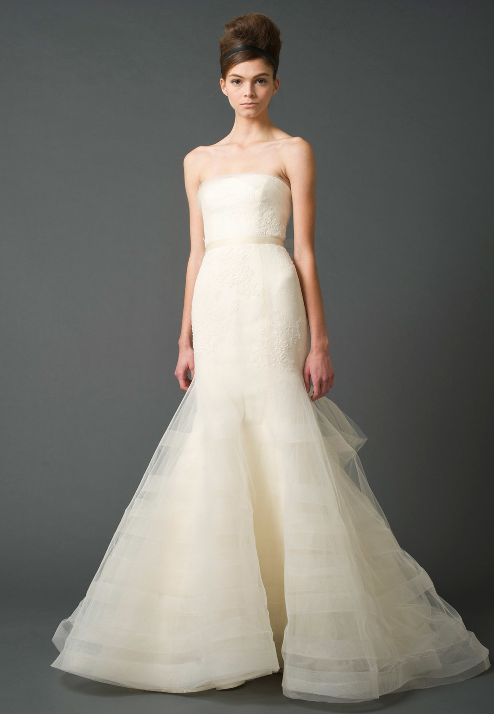Iconic Style    Gown: Georgina    Description:A strapless modified mermaid gown with fusions of shadow lace and Chantilly lace with multi-tiered tulle skirt and cascading bias horsehair trim.