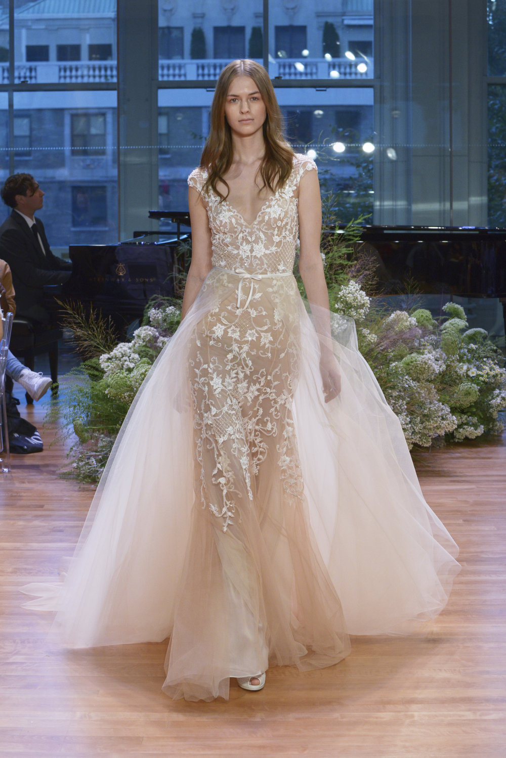Season: Fall 2017    Gown name: Pascale    Description: A cap sleeve modified A-line gown with embroidered bodice and a detachable tulle overskirt.