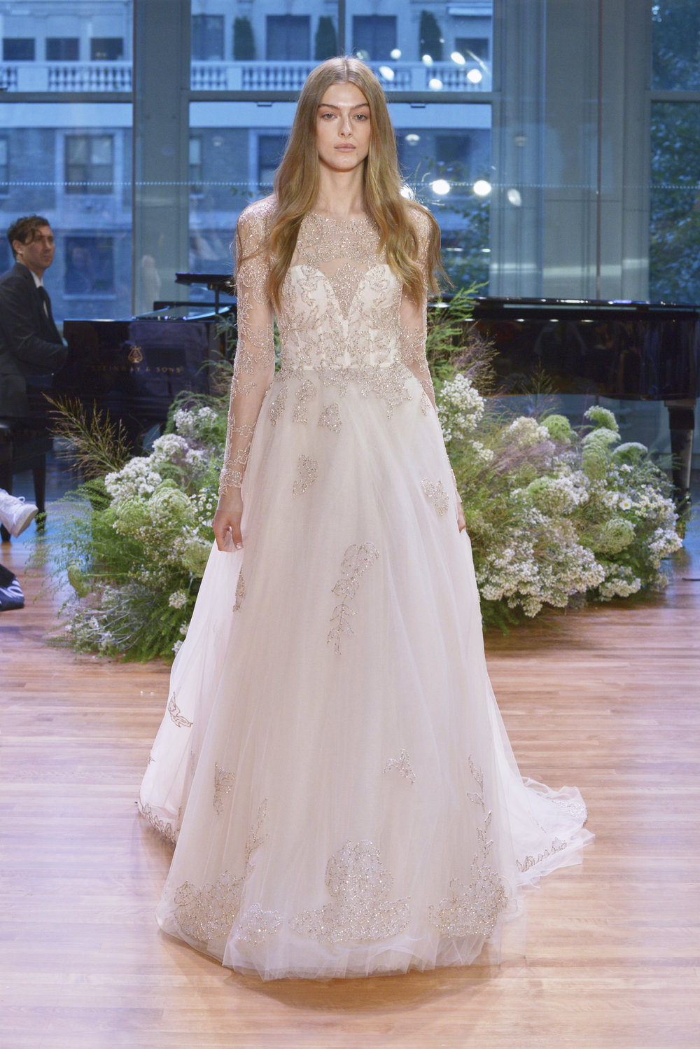 Season: Fall 2017    Gown name: Rhapsody    Description: An illusion long sleeve A-line gown with embroidery on bodice and skirt.