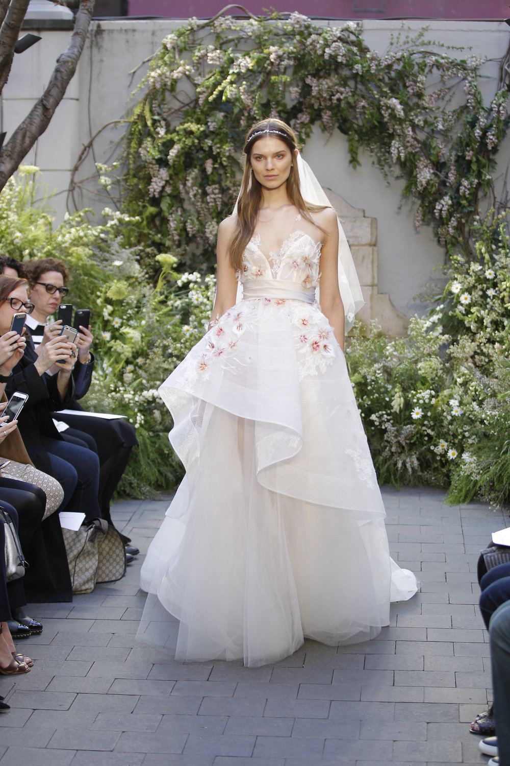 Season: Spring 2017    Gown name: Blossom    Description: An illusion V-neck high low tulle ball gown with hand painted flowers and ombre gazar cummerbund.