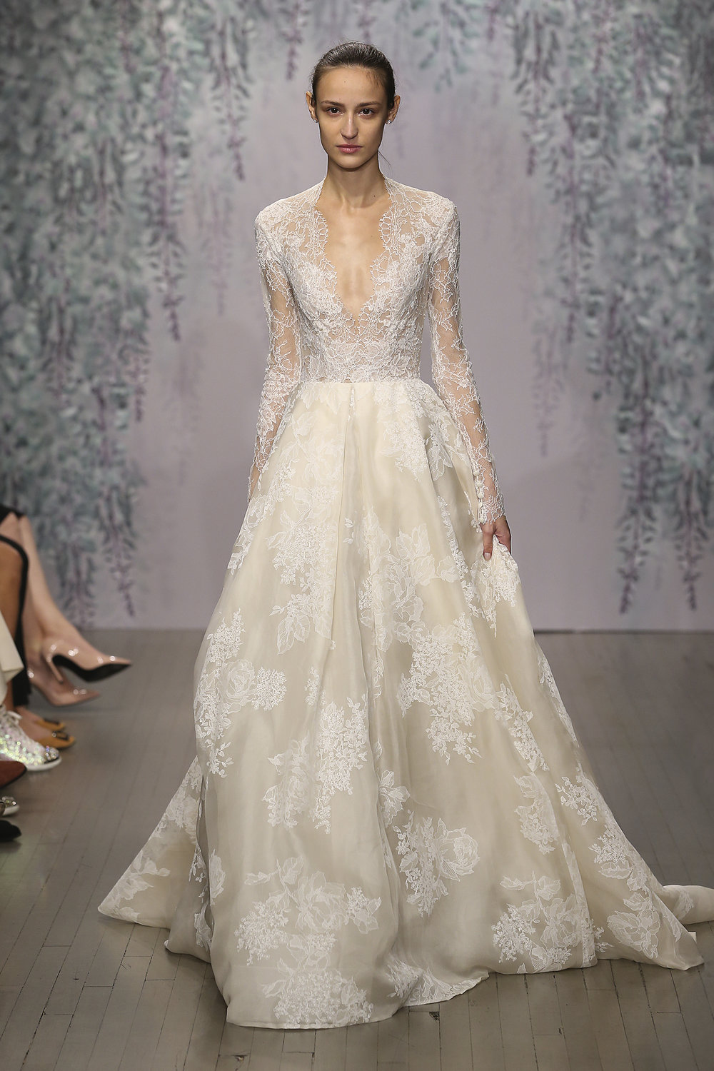 Season: Spring 2017    Gown name: Winslet    Description: An illusion long sleeve V-neck lace ball gown with keyhole back.