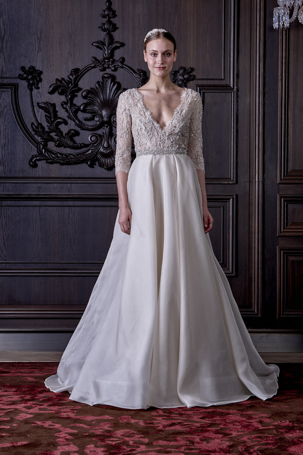 Season:Spring 2016    Gown name: Cadence    Description: A plunging V-neck bodice with ¾ sleeves, low open back and full skirt.