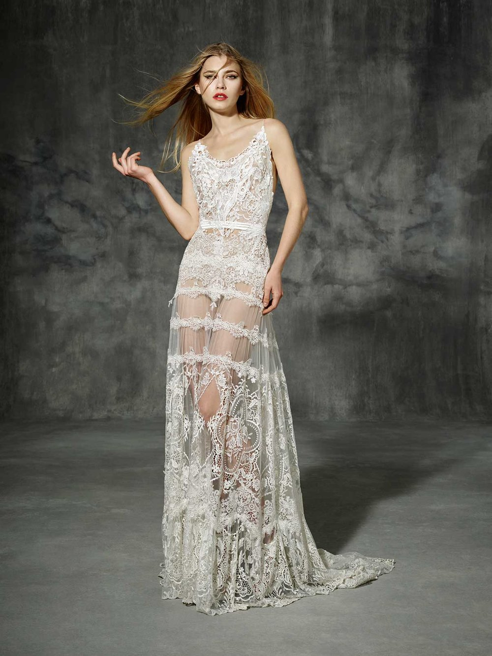 Season: 2016    Gown name: Muntaner    Description: An embroidered tulle gown with low round neckline and flowing skirt.