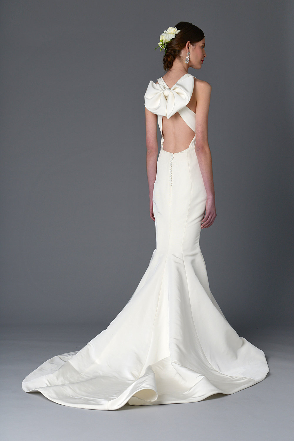 Season: Spring 2017    Gown name: Wisteria    Description: A mermaid, silk faille gown with plunging V-neck and bow detail at back
