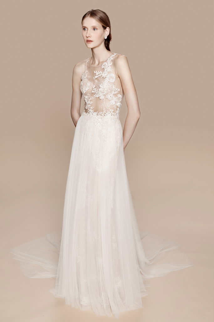 Season: Fall 2017    Gown name: Chelsea    Description: A sleeveless embroidered gown with tulle skirt and chantilly lace underlay.