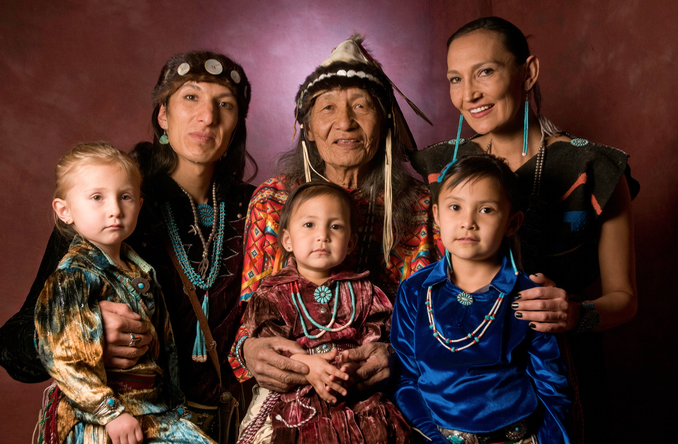 The Benally Family - World Champion hoop dancer and traditional healer Jones Benally, his daughter Jeneda, son Clayson and three young grand children for the Jones Benally Family Dancers. These three generations together bring the healing power, beauty and profound messages of the Navajo (Diné) culture to educate and uplift audiences. The Jones Benally Family give an unparalleled introduction to Navajo music and dance.