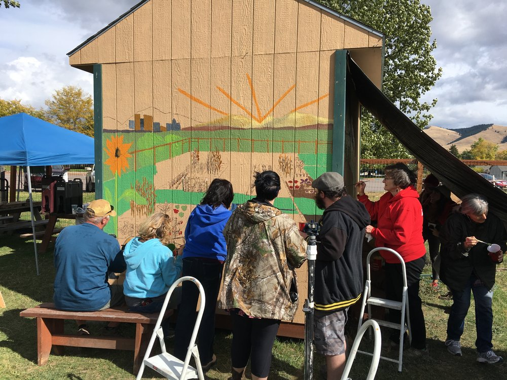 One of the ways that the Garden of Eaton came together: when one of the long time gardeners, Frank, passed away, the gardeners got together to pain a mural on the shed in his honor. Colin and Kim were a big part of the painting party. They are here, in matching camo.