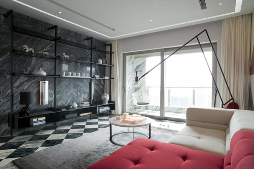 The living room with the marble wall and floor