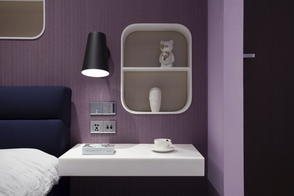 MASTER BEDROOM The custom made bedside table in Corian and Abet laminate