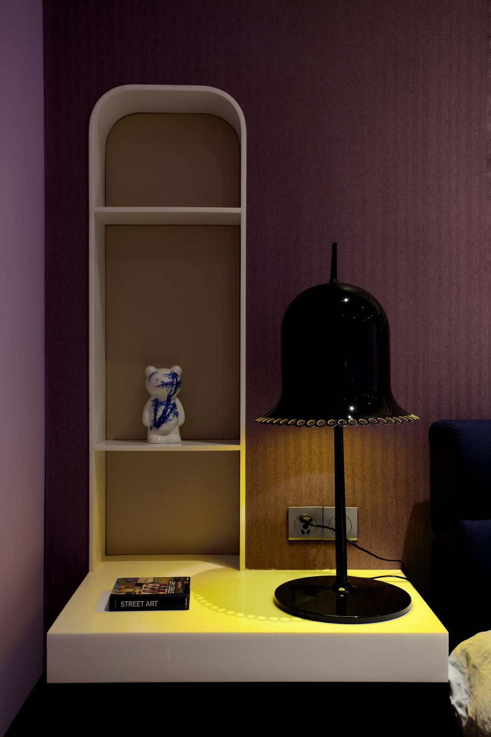 MASTER BEDROOM Lilac textured walls with Corian headboard and shelving system. On the table Lolita lamp by Moooi