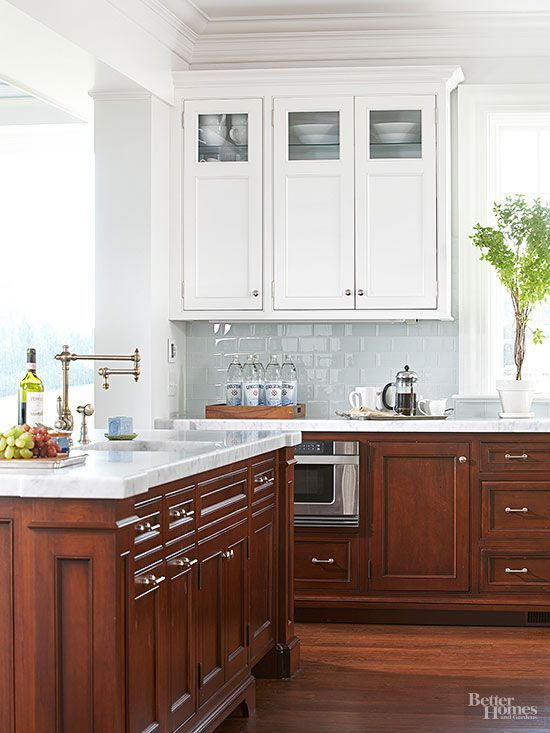 Upper cabinets with a white-painted finish keep this kitchen light and bright. Source  Better Homes & Gardens