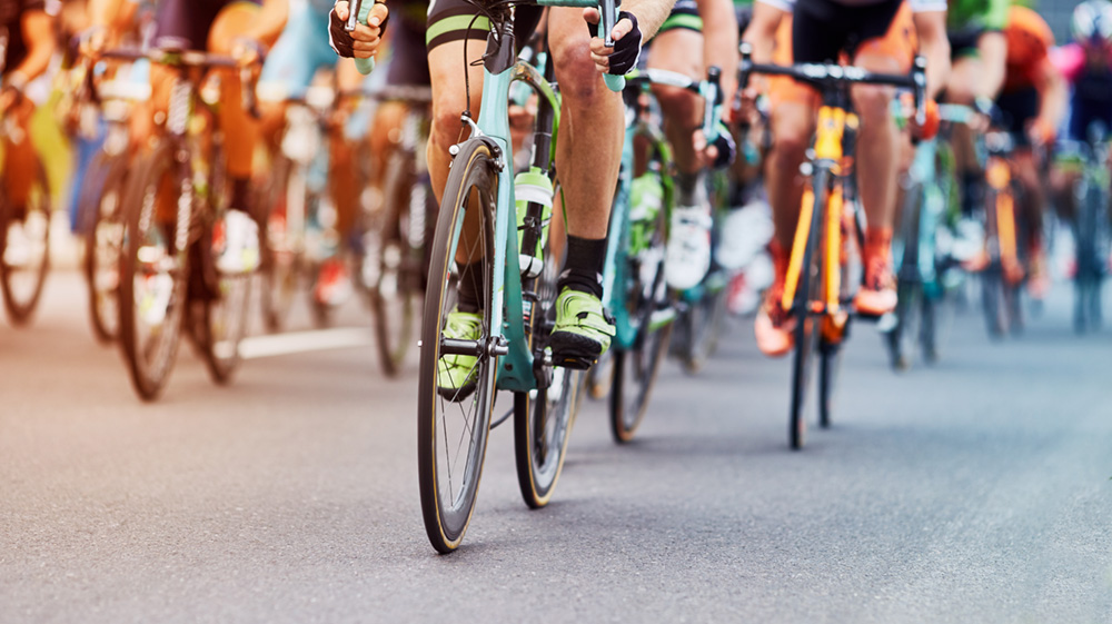 Photo of a cycling race with multiple bright colors
