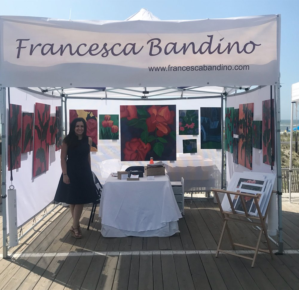 In my tent and with my paintings at the Boardwalk Art Show