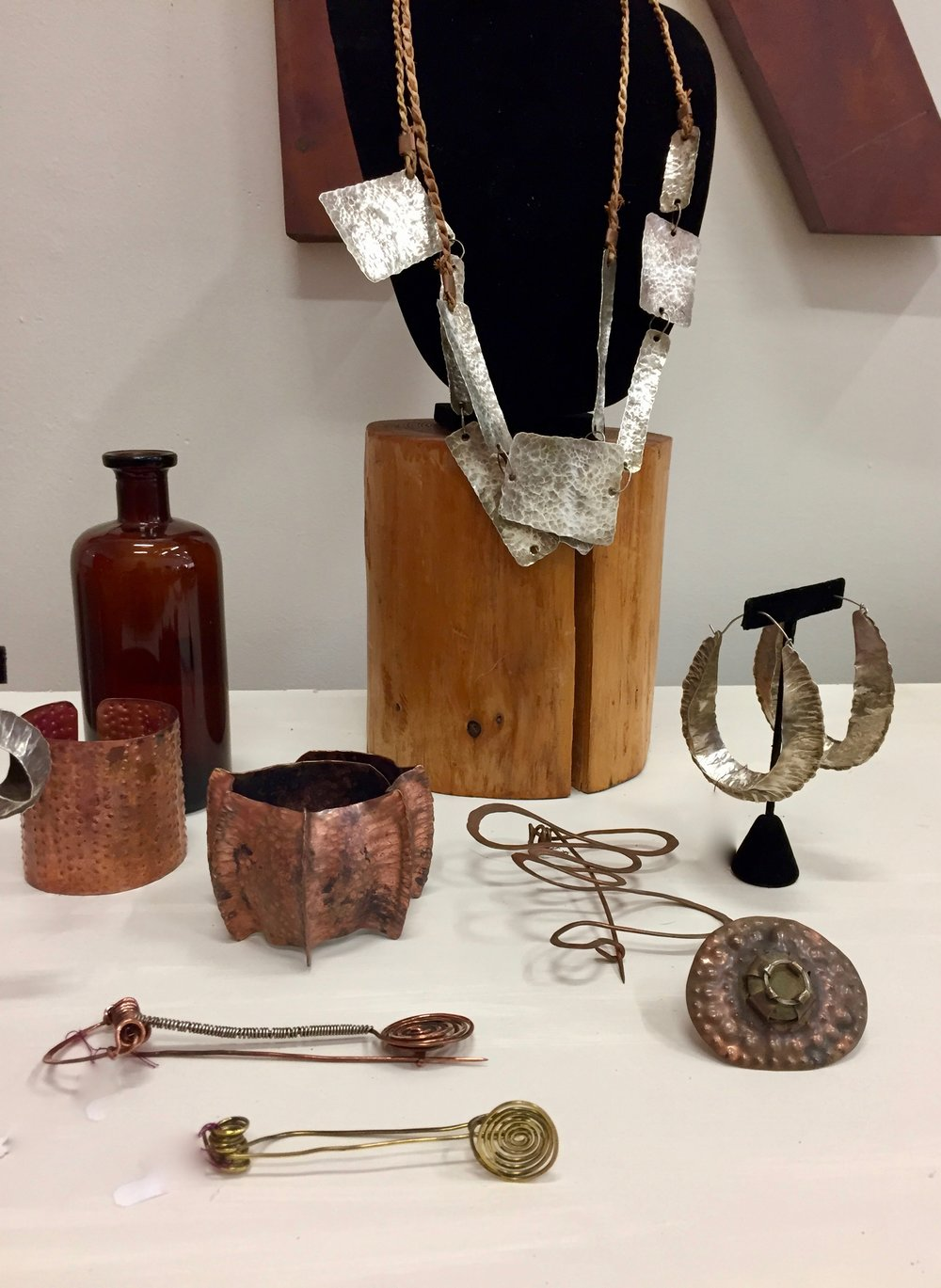 Modern, ethnographic jewelry by David Blakesley including bold, hammered adornments in copper and silver.