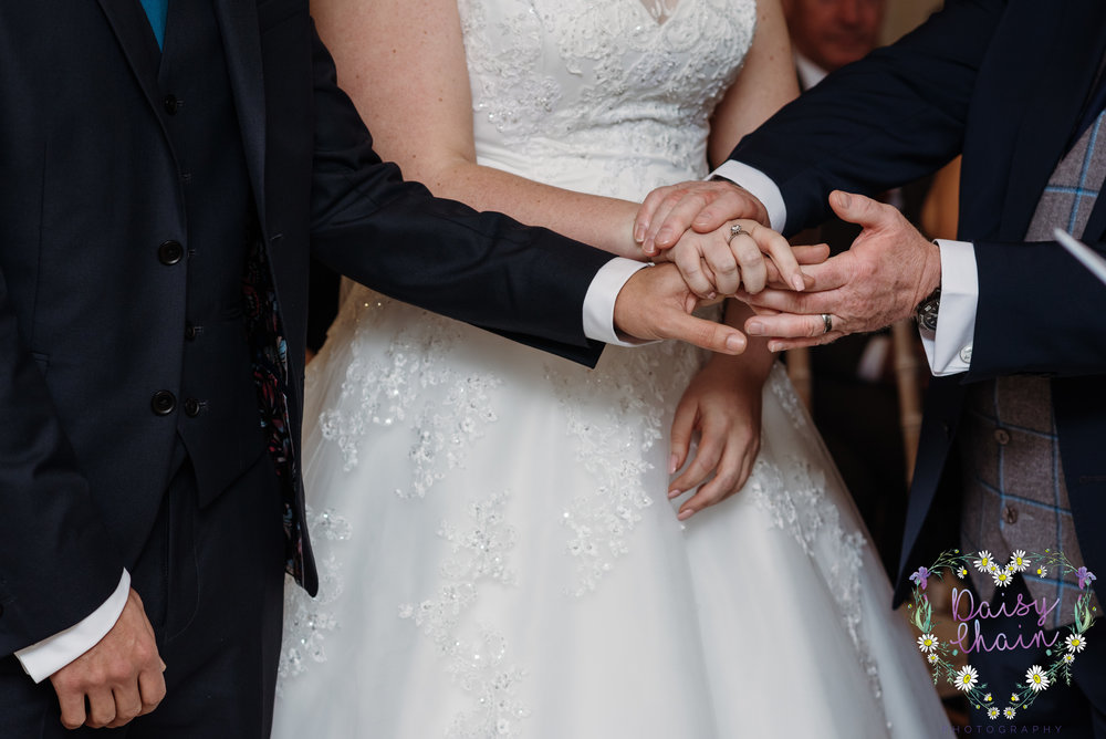 Joining hands - cheadle house wedding