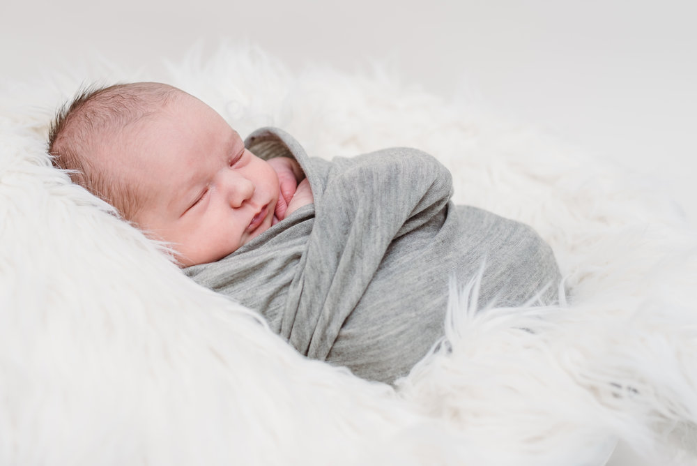 Newborn photography - snug as a bug