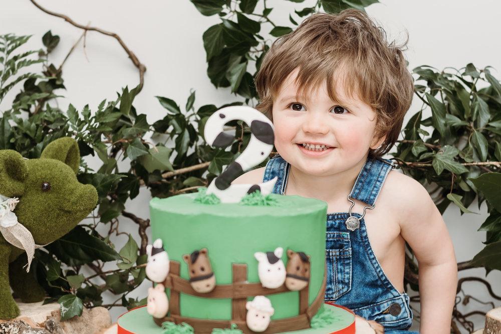 Smiling birthday boy - cake smash