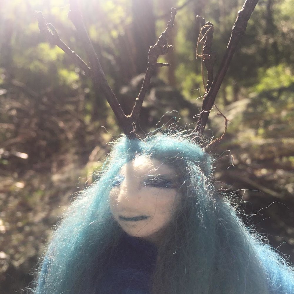 Spirit of the Birch Tree Doll - Filled with Vervain the herb of enchantment and Birch bark she wears antlers made of Birch twigs. She was created at a workshop dedicated to the story of Baba Yaga and the Birch forest that surrounded her hut that stood on chicken legs. This is a tree spirit.