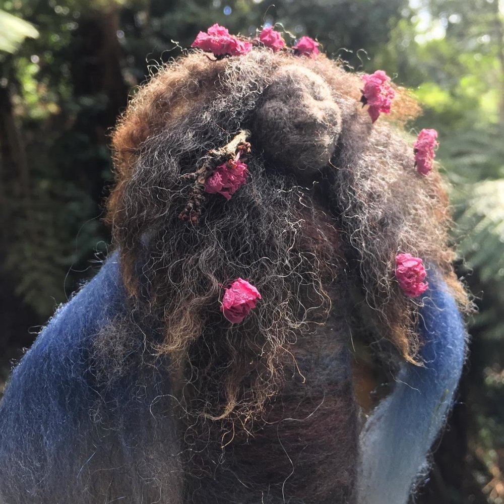 Spring St John's Wort  Doll - Hair woven from raw fleece gathered by hand in Tasmania and adorned with cherry blossoms. She is filled with a medicine bundle holding the ancient healing herb St. John's Wort.