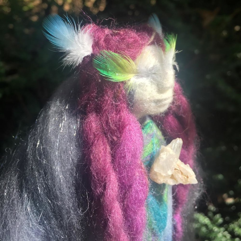 The Dreamer Plant Mother - made from fleece woven with Agave Cactus and dyed naturally with plants, she has feathers for eyelashes.