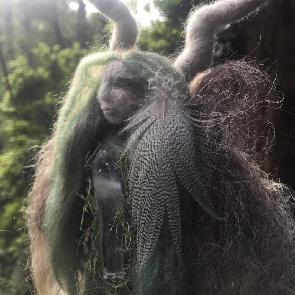 Of Moss and Stone Doll - Dressed in ancestral Scottish fibre from the Soay sheep from the Isle of St Kilda in the Outer Hebrides and moss from Sherbrooke Forest over her heart.