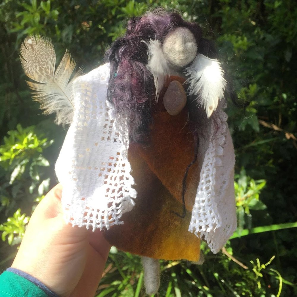 Owl Healer Sister Doll - Dressed in a wool dyed naturally with eucalyptus, she wears a sacred stone over her heart from Isla de la Luna at Lake Titicaca in Bolivia.
