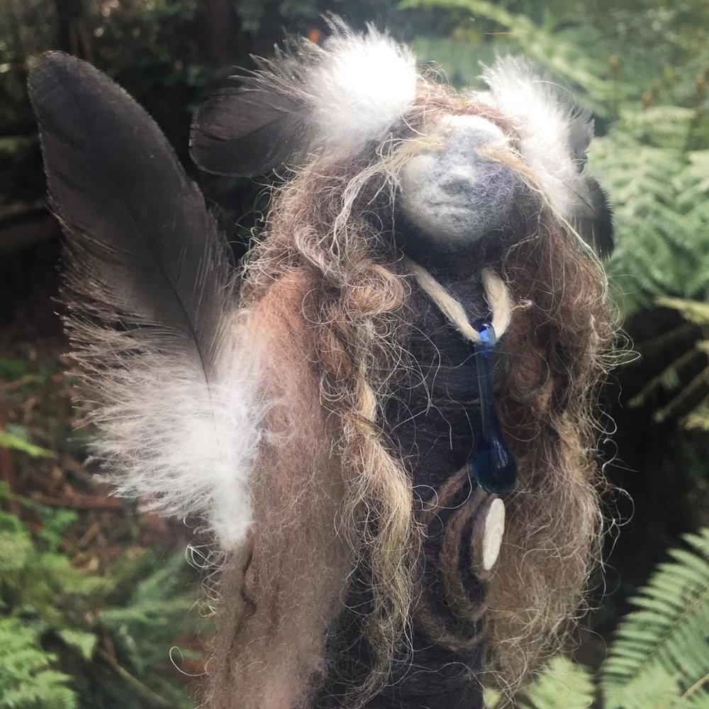 Crow and Nettle Spirit Doll - She is a Shadow work doll with eyelashes of Nettle fibre and wears the feathers of her ally and familiar the Crow.