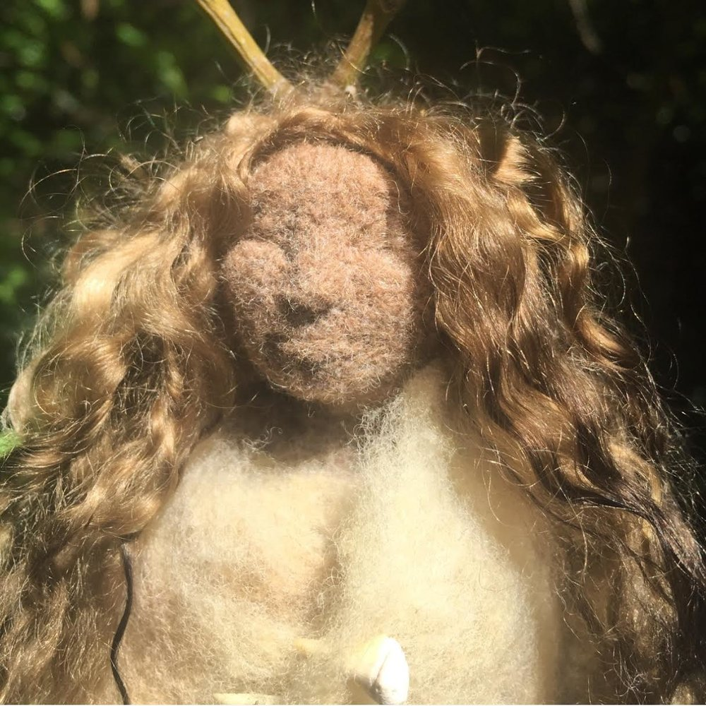 Golden Sun Eucalyptus Doll - Dressed in pure merino wool dyed eucalyptus leaves by us here in Sherbrooke Forest. her jacket has is held with fossilised shark teeth and she has antlers topped with flower buds.