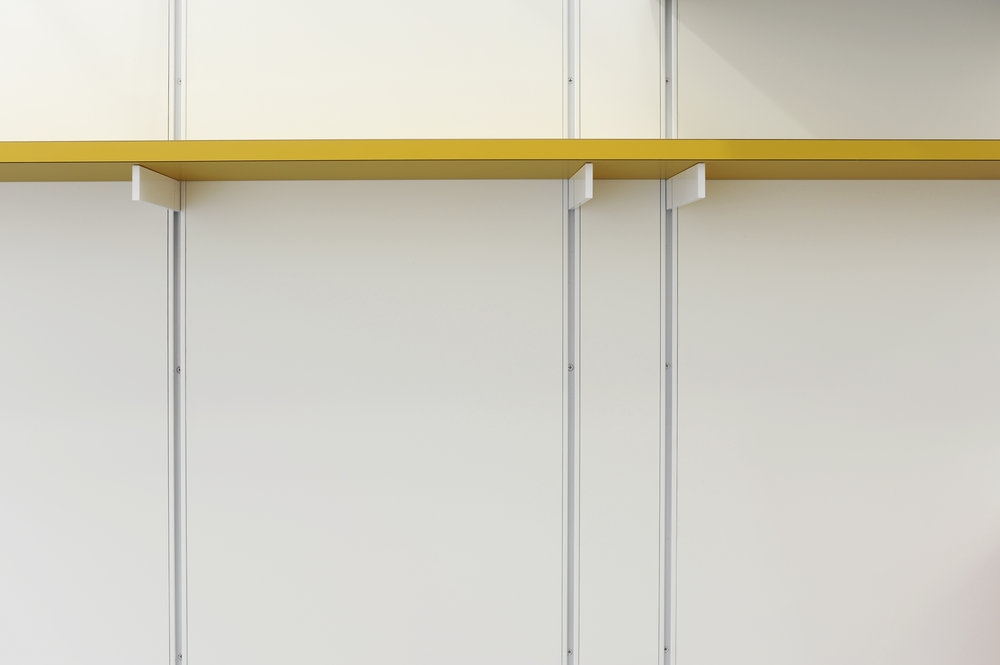 yellow shelf white wall.jpg