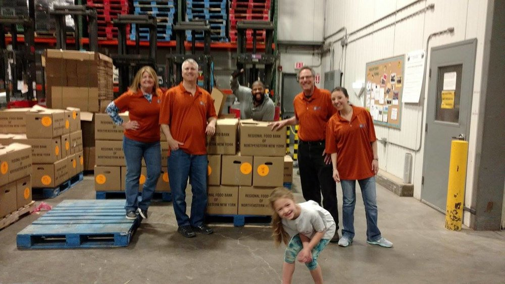 Team poses at Regional Food Bank