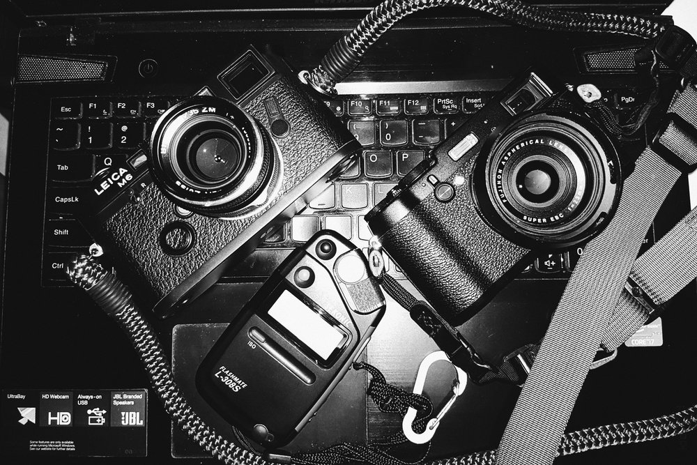 My Leica M6 which is a pleasure to use manually and my Fuji X100T which I recently prefer to set on aperture priority.