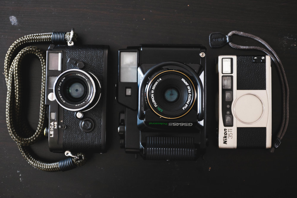 All for my film lust. Leica M6, Fuji GS645S, and Nikon 35Ti.