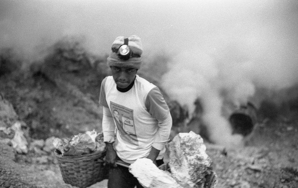 This photo was of a sulfur miner from Indonesia. The image isn't sharp but the photo was able to show the hard work these miners need to endure through this photo.
