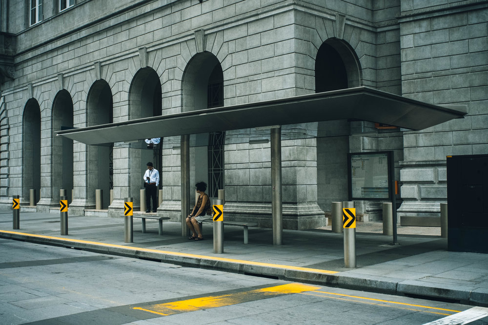 Parliament Place, Singapore. 2018  Gray tone, almost desaturated scene with striking yellows to hook the viewer;s eye.