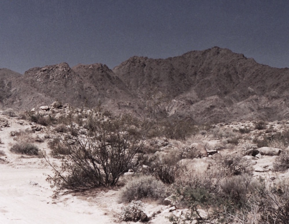 The Dead Mountains Range as seen from the Mojave Road, not far from the point where Hilton painted his work in 1935