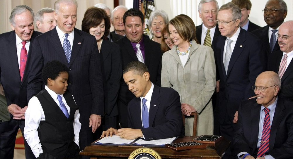Former President Barack Obama signing the Affordable Care Act.   ©  Washington Post.