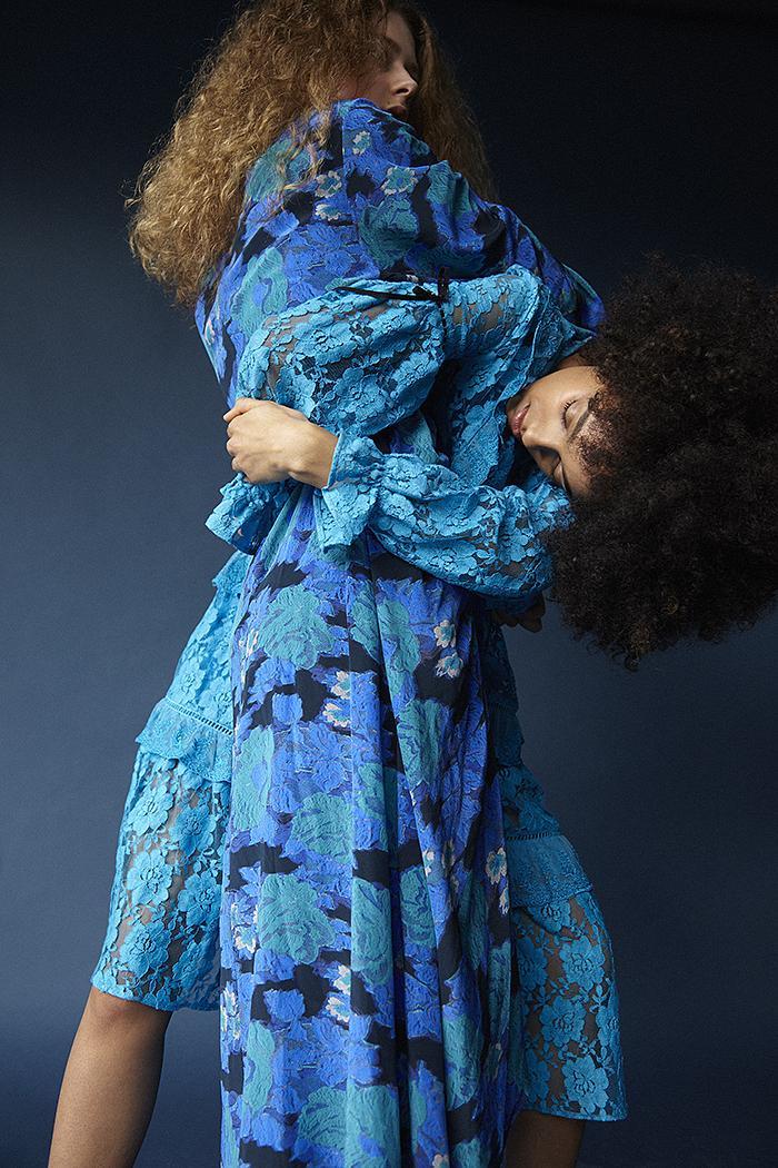 Erin wears blue floral dress Preen by Thornton Bregazzi. Nadia wears blue lace dress Preen Line