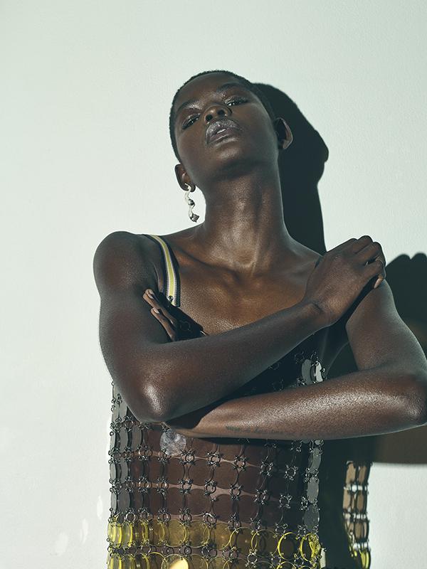 Plastic top by  Mary Katrantzou , earring by  Zohra Rahman