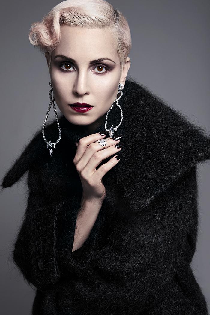 Coat and earrings: Miu Miu / Ring: Jessica McCormack