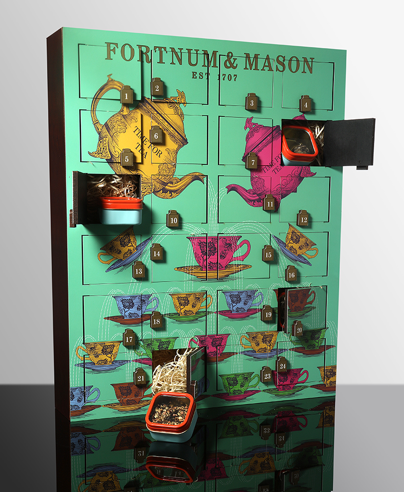 Fortnum & Mason   Count down the days to Christmas with a cup of Fortnum's extraordinary Rare Tea in hand.The Rare Tea Wooden Advent Calendar really does delivery a merry tea – not to mention a delicious sensation every day.   Fortnum & Mason Rare Tea Wooden Advent Calendar - £125.00